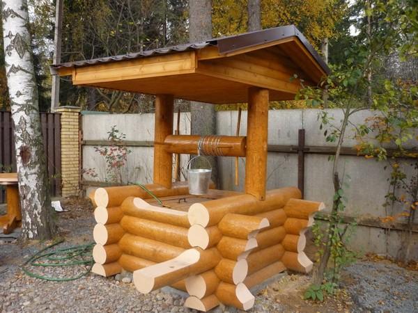 домик для колодца из бревна фото