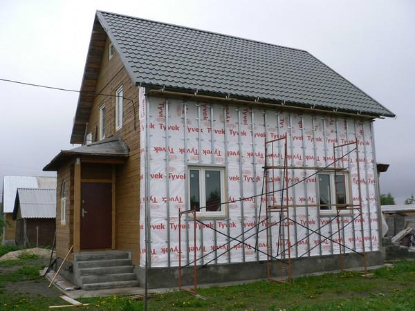 облицовка дачного дома сайдингом фото